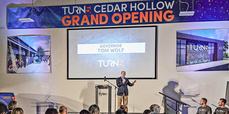 Governor Tom Wolf addresses a crowd of Turn5 employees